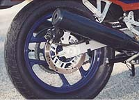A rear disc brake is a unique feature among the three bikes in this test.