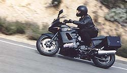 Kawasaki's GPz1100 feels planted and stable during fast cornering, due to its lengthy 59.4 inch wheelbase.