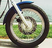 Despite its excellent rear brake, the front requires a ham hand and gobs of lever effort to mash it to a stop.