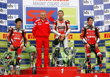 Davide Tardozzi, second from the left, stands on the podium with three of his former riders, from left, Noriyuki Haga, Troy Bayliss and Troy Corser. Tardozzi and Corser will be reunited in 2010 with BMW.
