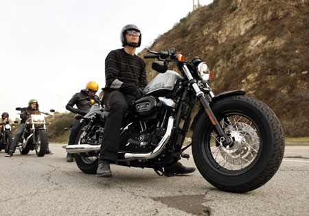"The 26-inch seat height, under-mounted mirrors and ""slammed"" rear suspension give the Forty-Eight a low profile."