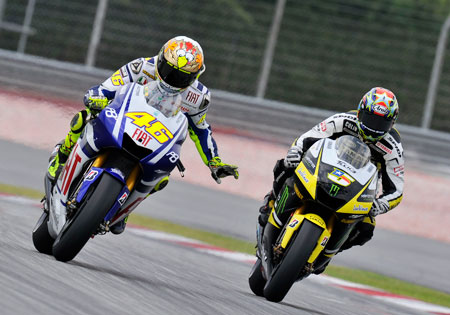 Valentino Rossi and Colin Edwards take to the track in Malaysia.