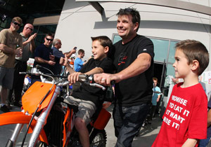 Designer Troy Lee with his son and his brand new KTM 65SX.