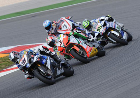 Leon Haslam (91) leads a pack that includes Max Biaggi (3), Cal Crutchlow (35) and Carlos Checa (7).