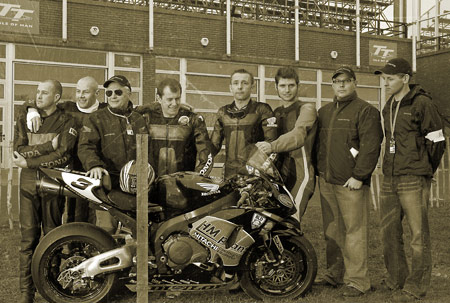 Ther 2009 HM Plant Honda team, from left to right: Nick Crowe (sidecar rider), Mark Cox (sidecar passenger), Neil Tuxworth (Head of Honda (UK) Racing), John McGuinness (rider), Steve Plater (rider), Guy Martin (Hydrex Honda rider), Havier Beltran (team manager), Julian Boland (mechanic).