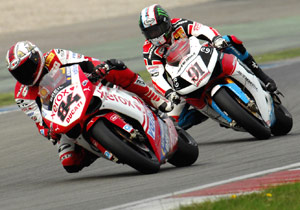 Michel Fabrizio holds position ahead of Leon Haslam.