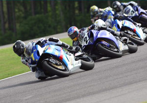 Mat Mladin leads Ben Bostrom on his way to another victory at Barber Motorsports Park.