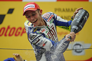 After heavy rain in Shanghai stopped before the race, but a victorious Valentino Rossi provided his own showers afterwards.
