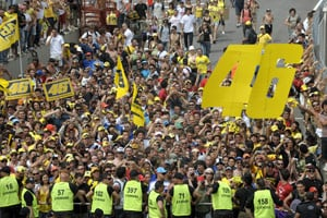 Members of the Valentino Rossi's official fan club celebrate their idol's success at Mugello.