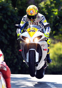 Valentino Rossi, shown riding the Isle of Man TT circuit, will race 3 other Yamaha champions.