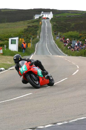 Ron Barber won the 2009 TTXGP race on the Isle of Man on the AGNI X101.