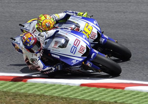 Jorge Lorenzo (99) and Valentino Rossi had a close race on Sunday and were close again in Monday's test.