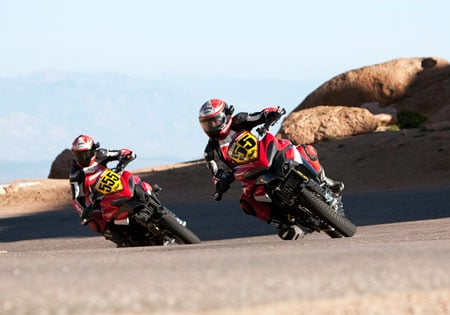 Alexander Smith (55) and Greg Tracy (555) ride the Ducati Multistrada 1200 in the 2010 Pikes Peak International Hill Climb.