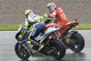 Casey Stoner and Valentino Rossi congratulate each other after finishing one-two at Sachsenring.