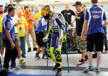 Valentino Rossi walks away on crutches after riding an R1 at Brno.