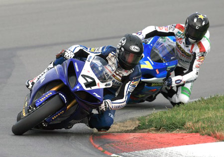 Yamaha's Josh Hayes stays in front of Suzuki's Mat Mladin.