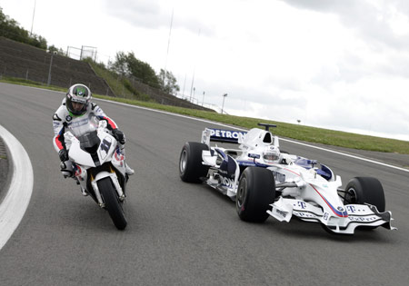 BMW WSBK racer Troy Corser and F1 driver Nick Heidfeld got to ride each other's machines at the Nurburgring.