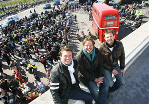 From left to right, Russ Malkin, Charley Boorman and Mungo in front of their convoy of motorcyclist.