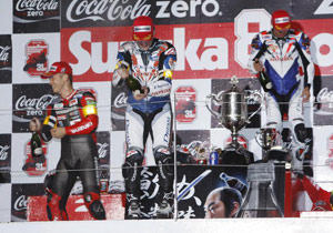 From left to right, Atsushi Watanabe, Carlos Checa and Riyuichi Kiyonari celebrate on the podium after the 31st Suzuka 8 Hours.