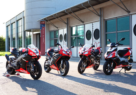 From left, Max Biaggi's WSBK-spec Aprilia RSV4 and its race replica RS125, RS50 and SR50.