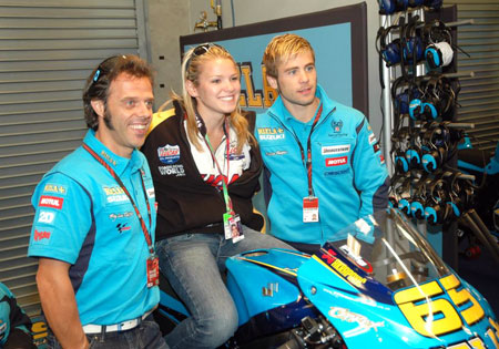 Elena Myers, flanked by Loris Capirossi (left) and Alvaro Bautista (right) got to sit in the saddle of Capirossi's Suzuki GSV-R at Laguna Seca.