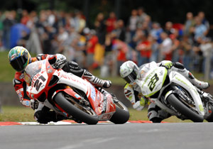 Troy Bayliss had tire problems in both races but still managed to increase his lead in the standings.