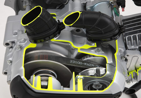 Air intake and exhaust ports on top of the CV-Matic's transmission case and a oil cooler on the right keep the drive belt cool.