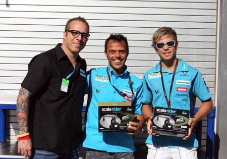 Rizla Suzuki racers Loris Capirossi and Alvaro Bautista receive their G4 PowerSet motorcycle communication systems.