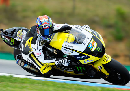 Colin Edwards will remain with Tech3 for the 2011 MotoGP season.