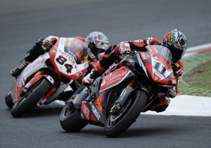 Michel Fabrizio (left) did his job as Troy Bayliss' teammate by overtaking Troy Corser (right) in race two.