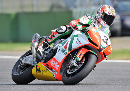 Max Biaggi has signed on to race two more years for Aprilia.