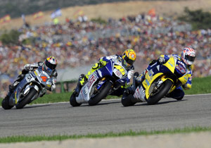 Valention Rossi fights for position ahead of Andrea Dovizioso and behind Colin Edwards.