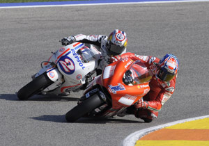 Dani Pedrosa, racing in a special one-off white livery honoring Repsol's 40 years of motorsport sponsorship, finished second behind Casey Stoner.