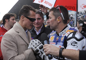 Michael Schumacher met with WSBK Champion Troy Bayliss between races at the season finale in Portimao.