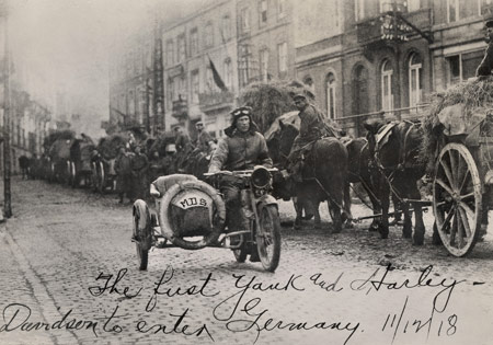 "From Harley-Davidson Archives, the writing reads ""The first Yank and Harley-Davidson to ener Germany. 11/12/18"". Copyright H-D."