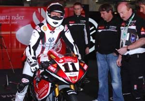 Michael Schumacher gets ready to take Troy Corser's Yamaha R1 for a spin.