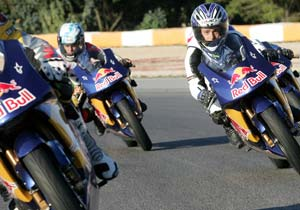 Riders try out for the 2009 MotoGP Rookies Cup. Arthur Sissis (right) made the cut.