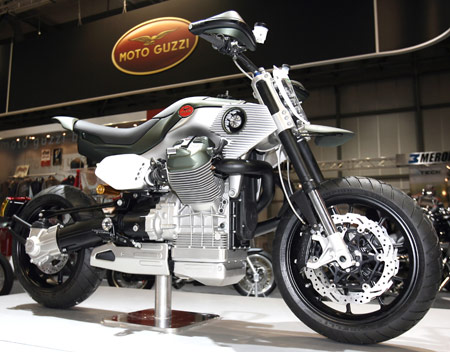 The Moto Guzzi V12 Strada has touring-style handlebars and a banana-style seat like it's Piaggio family relative, the Aprila Mana X.
