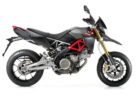 The Aprilia Dorsoduro Factory gets carbon fiber parts and red steel trellis frame.