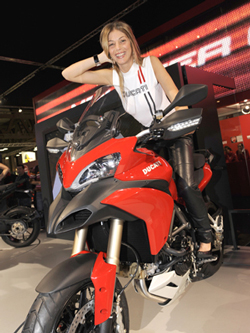 A model displays the new Ducati Multistrada 1200, and a new Ducati retro '80s style sleeveless top.